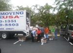 Chesed of Florida volunteers unloading the Food